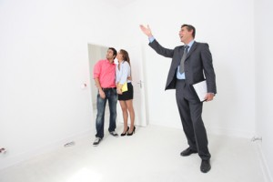 Couple being shown around property by estate-agent